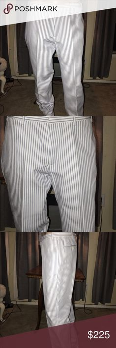 Men's pants Men's designer Calvin Klein stripped pants brand new . They are not hemmed . Pictured is the length of pants . Calvin Klein Pants Dress
