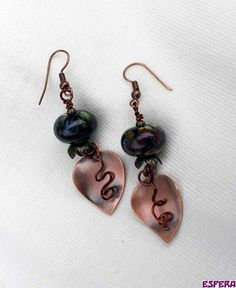 Beautiful lampwork beads from Lizbeads, combined with copper leaf and brass.