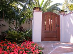 Custom Wood Gates by Garden Passages Premium Wood Gates  Features: Wood Pickets and raised Panel Premium Stain Thick Body Emtek Hardware Heavy Duty Hinges  See More at: http://www.gardenpassages.com/premium-wood-gates