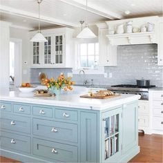 two toned kitchen cabinets. blue/gray island and white cabinets. blue/gray tile backsplash