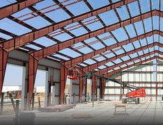 Pre-engineered metal buildings are incredibly useful in many applications due to their superior strength, versatility, and speed of construction. There is some basic equipment needed to erect a steel building quickly Building Companies, Building Systems, Building Materials, Building Design, Structural Steel Beams, Structural Engineer, Pre Engineered Metal Buildings, Steel Structure Buildings, Metal Structure