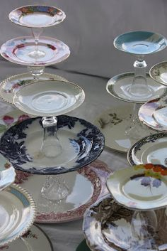 Create height for any centerpiece with a couple of dinner plates, wine glasses, and a saucer.