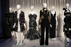 """Mannequins form the costume institute exhibition """"Punk: Chaos to Couture."""" including the 1994 Moschino dress made of garbage bags (center)."""