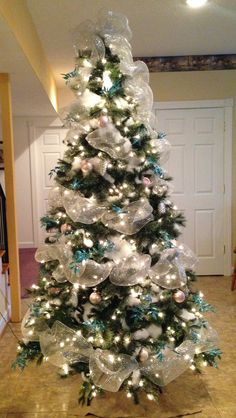 Christmas tree with silver mesh, fake snow, pale pink and pale blue ornaments