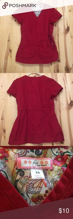 Koi Scrub Top XS Red EUC Great Price Buy Now Koi Red Scrub Top XS Has 2 Front Pockets and ties on the side Excellent Used Condition Koi Tops