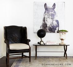 An entryway nook in Lea Michele's West Hollywood home. DIY the horse on plywood with mod podge using large prints from Office Depot, need to go take horse photos