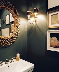 I like the idea of a dark blue or green powder room with the gold faucet and gold light fixture on the wall….a wood frame may be a nice contrast