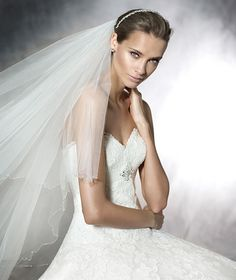#Exciting #news #Pronovias #barcelona #2016 #collection has arrived. Here is a #sneakpeek for you and keep #watching for more. Bridal A-line tulle with lace applique. Bust with heart-shaped neckline and draped details of tulle with embroidery gem stones in the center. Back decorated with ribbons that tie in corset style. Pronovias Wedding Dresses keep evolving as world leaders in bridal couture gowns, creating unique new looks every season www.instylebridal.com.au