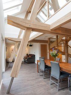 Oak framed living area - timber frame houses by Carpenter Oak Ltd