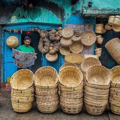 A shopkeeper selling his wares.