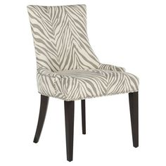 Perfect at the head of your dining room table or accenting the den seating group, this chic upholstered side chair showcases a beech wood frame and zebra-pri...