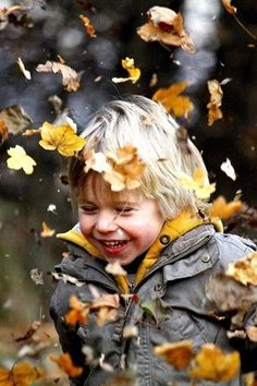 Nothing like playing in the leaves in the innocence of childhood...sweet memories