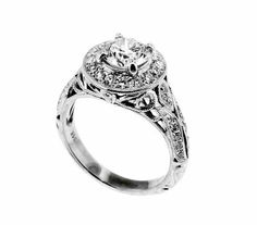 A 14k white gold, diamond, filigree ring.  The center diamond = 1.10 carats, I/J color, VVS2 clarity.  There are 42 round diamonds totaling 0.48 carats.  Priced: $7,250