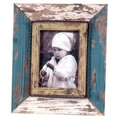 """Distressed wood picture frame with rope-twist detailing. Holds one 5"""" x 7"""" photo.  Product: Picture frameConstruction Material: Wood and metalColor: Distressed blue and whiteFeatures: Holds (1) 5"""" x 7"""" photoDimensions: 11.75"""" H x 9.75"""" W"""