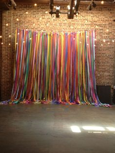 Gorgeous Bright Rainbow Ribbons curtain is the perfect back drop for your Summer or Festival wedding theme
