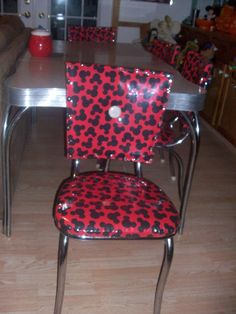 Vintage chrome and formice table and 4 chairs, chairs recovered with Mickey Mouse fabric and clear vinyl