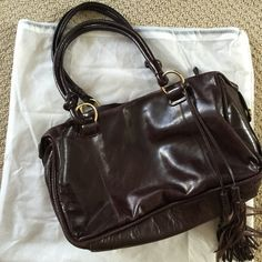 Donna Dixon Brown Purse Donna Dixon brown purse. Inside shows some wear and staining from makeup, but the outside of the bag is in great condition. A little flat from storage. Needs a good home! NO TRADES, POSHMARK ONLY. Donna Dixon Bags