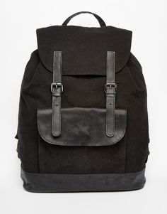 ef9bc1f03802 ASOS Backpack In Black Canvas With Leather Trims at asos.com