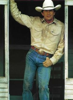 Mr. George Strait! No one can wear wranglers like him
