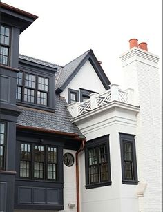 The white trim and railings are a custom color, starting with a base of BM China White.  The dark trim is also custom starting with a base of BM 1617 (Cheating Heart).  Painted brick houses: what color to paint the brick