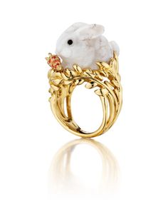 Fernita ring in 18k yellow gold has a 10.20 ct. t.w. carved Coober Pedy white opal bunny; by Mimi So via JCK   http://www.jckonline.com/blogs/style-360/2012/04/06/show-me-bunny-mimi-sos-rabbit-rings