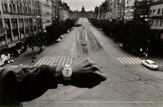 via http://kottke.org/06/11/josef-koudelka-prague-1968.. [the photo].. 'was taken by Josef Koudelka in Prague in 1968, just before the Soviet Union invaded and put a stop to The Prague Spring. To demonstrate the emptiness of the streets at noon, Koudelka stuck his wristwatch [actually another man's..] into the scene before shooting it. A simple, brilliant gesture that adds not only a temporal dimension to the photo but also a sense of solitary humanity in contrast to the empty streets.'