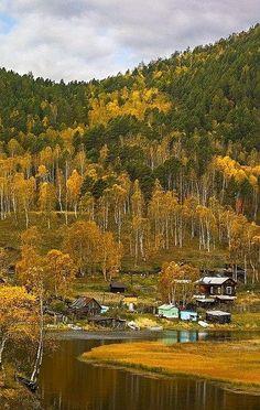 Small Russian village in Siberia. Autumn landscape.