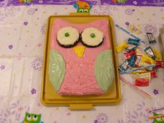 Owl Cake...so easy to make.  I made this for my daughters birthday.. Cut cresent shape from top of 9x13 rectangle cake then  trim 2 bottom corners. Frost and decorate with your favorite colors.    I used white frosting on Moon Pies and m & m's for the eyes.  Beth Ann Crowder 8/3/12