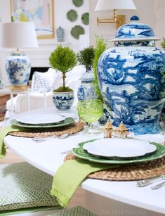 Breakfast table in The Pink Pagoda's Fall 2017 One Room Challenge™ with topiaries, Bordallo Pinheiro green cabbage dinnerware, L'objet accessories, and blue and white ginger jars. #outdoordinning