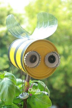 Perfect recycled tin can bees for around the playhouse.