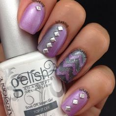 This nail art uses purple and gunmetal shades of gel polish highlighted with a chevron design and silver metal studs as accent. Recreate this edgy mani using the products here.