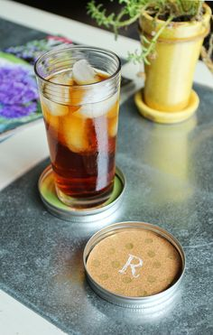 Make use of those  Mason jar lids and turn them into coasters by adding a little paint and cork. Get the tutorial at Less Than Perfect Life of Bliss.   - CountryLiving.com