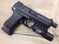 H&K HK45C with X300Loading that magazine is a pain! Get your Magazine speedloader today! http://www.amazon.com/shops/raeind