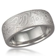 Awesome wedding bands for any slash couple! Just read a Mystrade story where they exchanged rings like these. Perfect. Mokume Gane - layers of platinum, sterling and 14k white gold.
