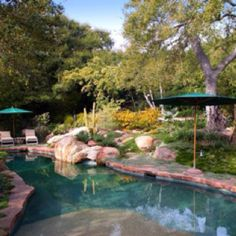 Natural feeling, hidden swimming pool pond.  (Love this!) (Source: Sotheby's Estates)