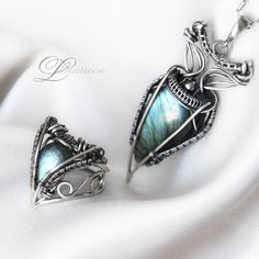 I don't do jewelry, but this is different. Handmade, Sterling Silver, Wire Wrapped, Gemstone Jewelry -Lunarieen