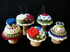 A few spool pincushions