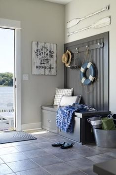 Ship shape: If your mudroom is part of a lakeside cottage, create nautical style by balancing modern finishes with weathered decor. Beach finds gain a worn look when covered with chalk paint. Tour more of this Michigan lake house here. Beach Cottage Style, Beach House Decor, Lakeside Cottage, Cottage Style Mudroom, Style At Home, Home Living Room, Living Room Decor, Living Furniture, Furniture Ideas