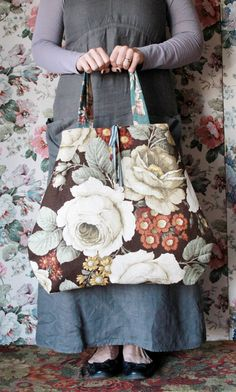 Meet Pia...she is a rather pretty bag made from a rare vintage floral Sanderson linen .  Not only does she like hanging out on your arm but she loves a stroll around an antique shop or two and then on for a spot of lunch and she likes to think she is not only a bag but a rather pretty accessory to your daily wear.  When not in use she likes to be hung on a wall so all can share in her beauty.She is approx 57cm wide at her widest point.This product is hand made and therefore ...