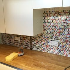 The splash back in our utility room - made using c1000 bottle caps.