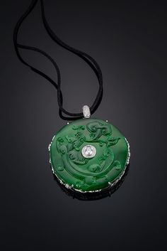 Jadeite jade carved dragon convertible brooch/pendant This jadeite convertible brooch/pendant set with a diamond and carved with the mythological green dragon of the East and spring, is a powerful symbol in Chinese mythology. Courtesy of On Tung, Hong Kong; photo by Robert Weldon © GIA