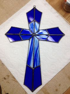 Both of these crosses are being used as an example of what can be made. They can be designed in many different colors, solid, or mixed design as shown. The size is approximately 12. They can be made larger or smaller. Colors are not always in stock, so you would have to open to additional choices. No two are ever the same.