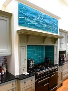 This beautiful bespoke glass wall art panel from Bo'ness, West Lothian is guaranteed to brighten up your day. While this panel could easily be a splashback, take a look again! The piece actually sits above the cooker, complementing a beautiful alcove tiled with strikingly similar colours.  The customers were looking for something that would tie into the overall décor and match the tiles behind the cooker. Glass Wall Art, Fused Glass Art, Glass Kitchen, Kitchen Art, Custom Glass, Bespoke Kitchens, Splashback, Panel Art, Alcove