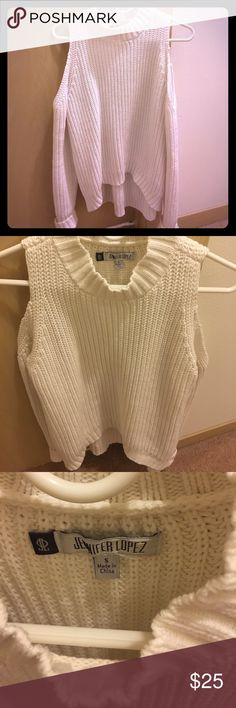 Jennifer Lopez cold shoulder sweater Gorgeous Jennifer Lopez cold shoulder white knit sweater. Love this top and I always received complements on it! Size S, slightly longer in the back.  Looks fabulous with leggings Jennifer Lopez Sweaters Cowl & Turtlenecks