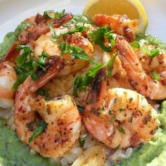 @Flavorgod Sautéed Shrimp over Cilantro Brown Rice with an Avocado Pesto  - Im not sure which ingredient (shrimp, cilantro rice or Avocado pesto)  was the star in this dish. They all were amazing! This is a Paleo dish if you take out the brown rice. - I sautéed the shrimp in some organic ghee butter, garlic and fresh lemon juice with @Flavorgod spicy seasoning. Cook time was about 6 minutes or until shrimp are pink.