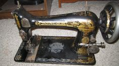 """a close up of another Singer """"Sphinx"""" Sewing Machine treadle machine made in 1902"""