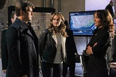Nathan Fillion, Stana Katic, and Jennifer Beals on the set of Castle season 4