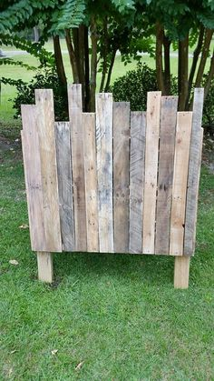 """Recycled Wood Pallets: This twin headboard is 50"""" high, 40.5"""" wide, and 4.5"""" deep. It sits 11"""" off the floor. Cost for all sizes of frames are as follows: Twin $75, Full $100, Queen $125, and King $150. These prices are for """"naked"""" headboards, costs will go up for painted and/or stained. These can be painted/stained for an additional cost.  Item # 275"""