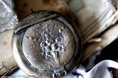 Nineteen century tarnished silver metal pill box locket