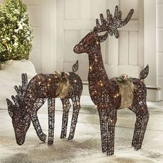 Outdoor Decorating: Take a natural approach to your outdoor holiday decorating by placing lit reindeer among your landscaping. Their warm glow is a lovely way to celebrate the season. Reindeer Decorations, Outdoor Christmas Decorations, Outdoor Decor, Christmas Yard, Simple Christmas, Merry Christmas, Outdoor Statues, Burlap Bows, Tole Painting